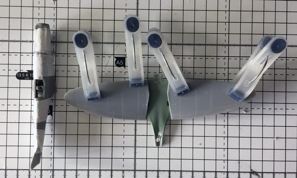 Work in progress on the Airfix 1/72 Spitfire PR.XIX  kit, gluing the wings together.